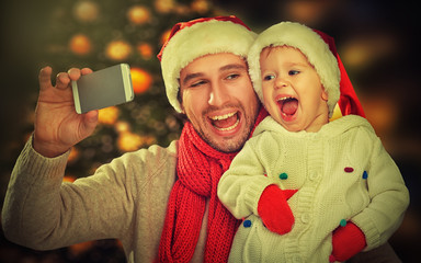 selfie  in Christmas. happy family dad daughter