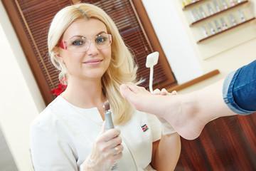 Pedicure specialist in beauty salon