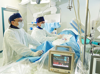 surgeons team at vascular surgery operation