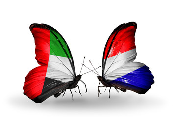 Two butterflies with flags UAE and Holland