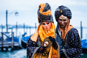 Couple in typical dress poses during Venice Carnival