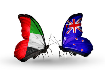 Two butterflies with flags UAE and New Zealand