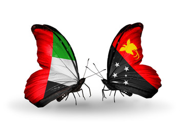 Two butterflies with flags UAE and  Papua New Guinea