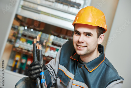electrician worker with cable - 74398197