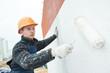 Leinwandbild Motiv builder facade painter at work
