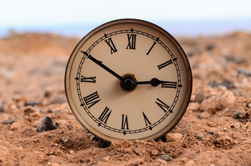 Classic Analog Clock In The Sand