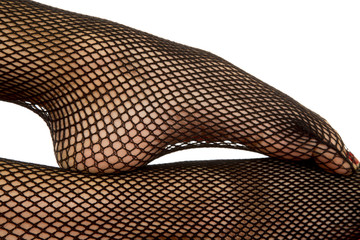Woman legs black fishnet close foot on leg