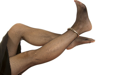 Woman legs in cuffs and black fishnet crossed