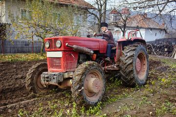 Senior farmer plowing