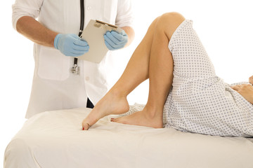Woman patient legs doctor holding clipboard