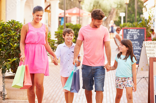 canvas print picture Family Walking Along Street With Shopping Bags