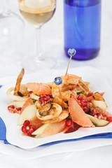 Celebratory fruit salad and seafood