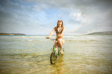 Riding a bike in the water