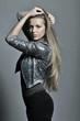 Young sensual model girl pose in studio