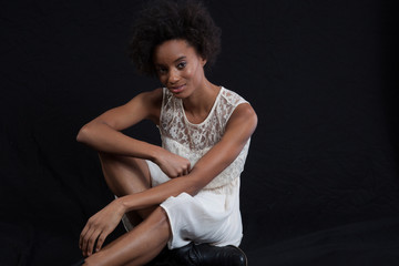 black woman sitting and smiling