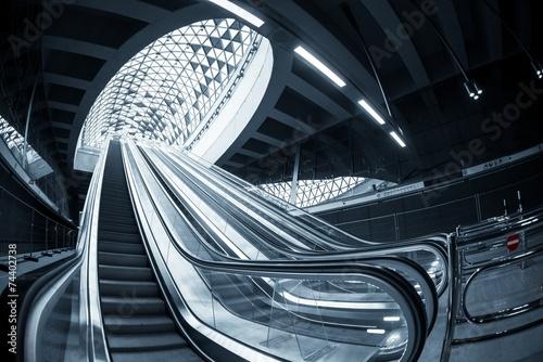 Staande foto Treinstation Moving escalator in the business center