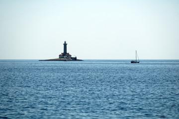 Old lighthouse on a rock island