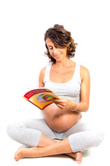 Pregnant Woman reading isolated on white background
