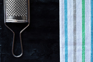 metal grater and tablecloth