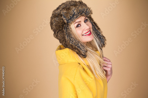 canvas print picture Pretty smiling blond woman in a winter hat