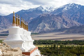 Buddhist stupa and Himalayas mountain. Shey Palace, India