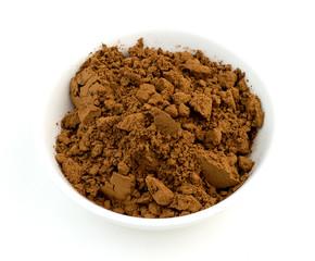 Chocolate cocoa powder closeup macro on white