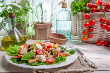 Spring salad in a sunny kitchen full of vegetables