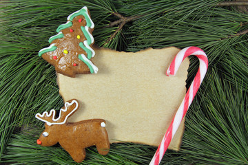 blank christmas card on fir tree with homemade gingerbread