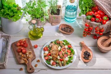 Caesar salad prepared in spring time