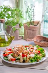 Caesar salad with fresh spring vegetables