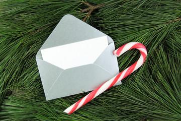 christmas silver envelope on fir tree