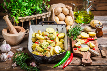 Preparations for baking potatoes with garlic and hebrs