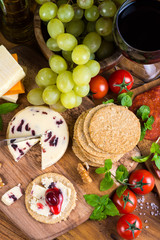 traditional english soft cheese with cranberry sauce