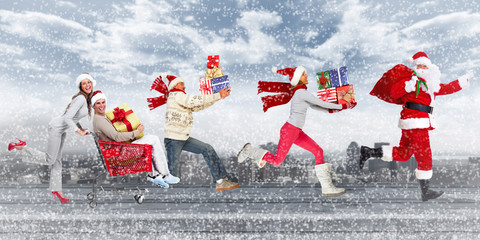 Happy people running with Xmas gifts