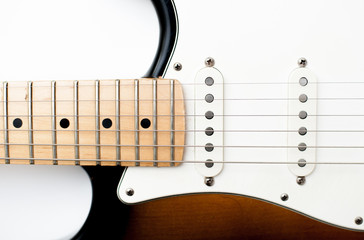 Detail of electric guitar neck and body