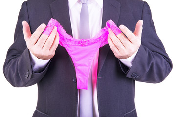Businessman holding a pink panties.