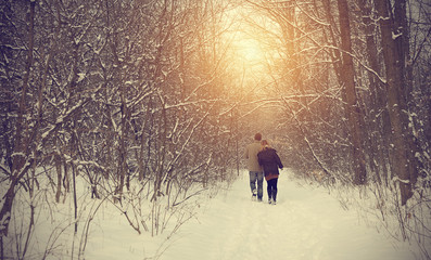 Couple on winter path in forest