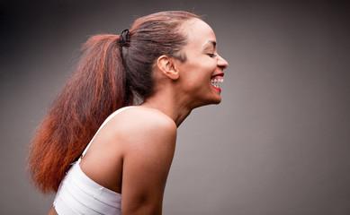beautiful afroamerican girl laughing under the light