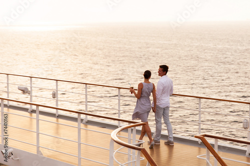 couple walking on cruise ship deck - 74410163