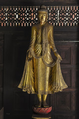 Gold Buddha statue Standing on Lotus Base