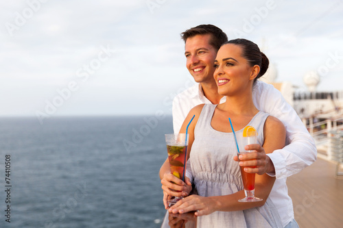 young couple on cruise trip - 74410508