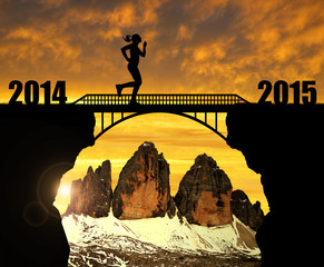 Girl running across the bridge to the New Year 2015