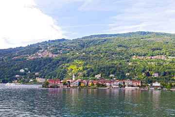 Panoramic view of Northern Italy town on the high lake bank