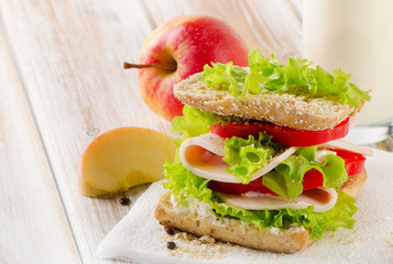 Sandwich with  apple  on   wooden table