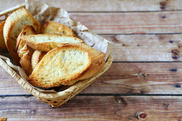 roasted baguette slices in a basket​​