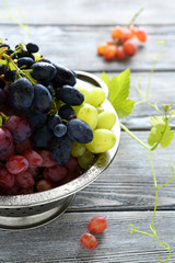 Fresh grapes in a metal colander