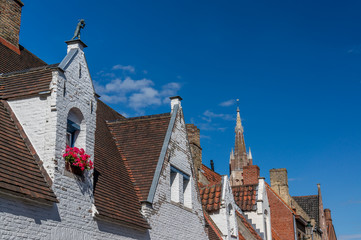 Traditional Bruges windows and rooftop architecture.