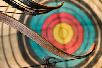 bow and arrows and target