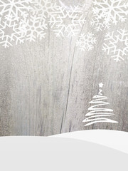 Christmas tree and snowflakes on wood background