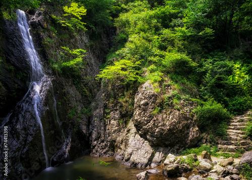 In de dag Bamboo Waterfall over a mossy creek taken in Wanju, South Korea